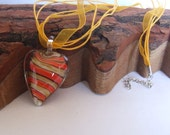 Orange, Coffee and Black Swirled Lampwork Glass Heart Pendant on a Gold Ribbon and cord chain with lobster clasp