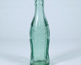 Vintage 1965 Coke a Cola bottle, made in  Denver, Colorado