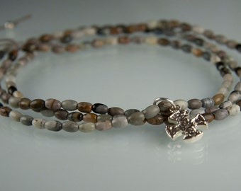 Winter Solstice Necklace - Picture jasper with a sterling silver maltese cross on silk