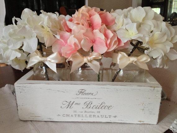 Wooden planter box centerpiece with three mason jars and
