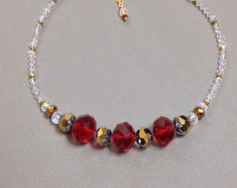 Crystal necklace, clear with red and gold accents