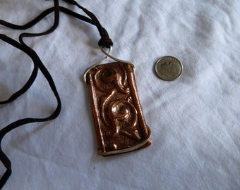 Chase and Repose Scroll pendant