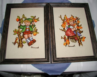 Two Hummel stitchery pictures with frames