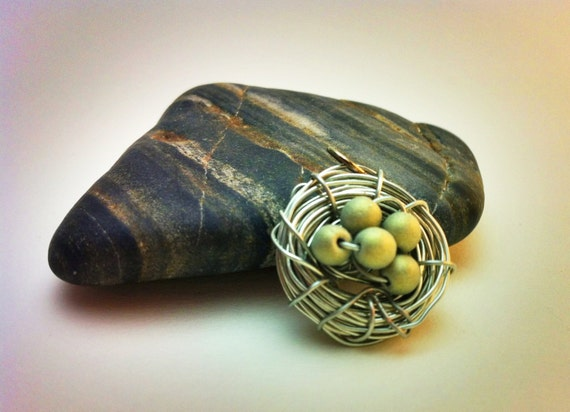 Bird's nest pendant - silver wire with 5 olive green eggs (beads)