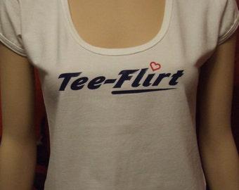 Medium white cap sleeve, scoop neck tee-flirt with latex print on front