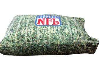 NFL rectangle dog bed. Dogzzzz tired of the same old plaids and stripes brings the rugged outdoors in and makes it fun.