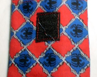 ... blue  red diamond design with belt or bag loop. allergies, bee stings