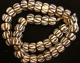 "Batik cow bone African trade beads, Kenya, vintage, 28"" strand, 20 mm to 25 mm"
