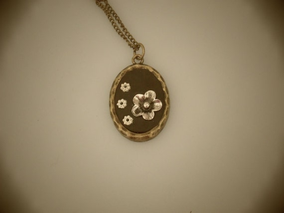 Bezel pendant using black Epoxy clay and silver flower charms