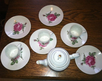 Vintage porcelain rose child's tea set!