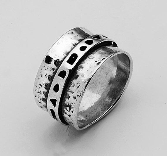 sterling silver hammered warp band ring by