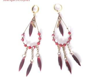 Earrings with drop pendants in burgundy color