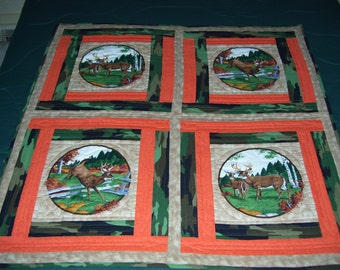 This is a fall quilt for all those hunters [women too] and could go on a wall or lap or table.It is hand quilted. Think Man Cave.