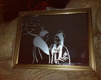 Etched mirror of a lovely couple.