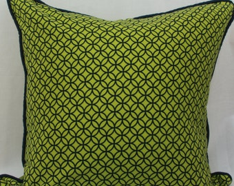 Lime green & navy geometric decorative throw pillow with navy piped trim. green toss pillow. green welted pillow.