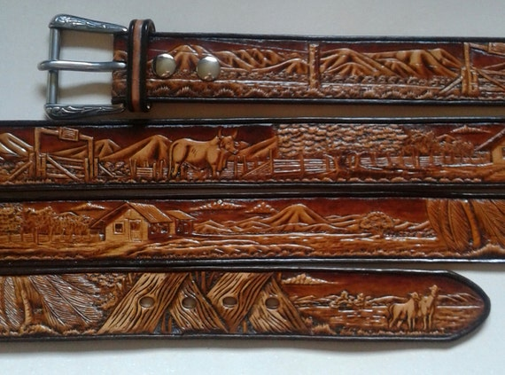 Wide hand carved western leather belt details a