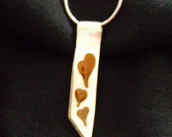 Spicy Hearts in Sterling Silver Ribbon Pendant