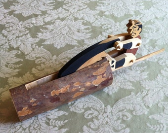 Japanese folk art woodcutter mechanical toy.