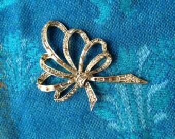 Amber rhinestone bow brooch