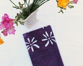 daisy tea towel in purple