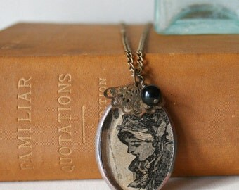 Antique Image Girl Wearing Bonnet Pendant with Charms on Brass Chain