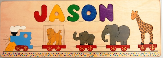 Wooden Name and Circus Train Puzzle for kids and toddlers, custom made. A memorable birth, shower, or first birthday gift for boys or girls.