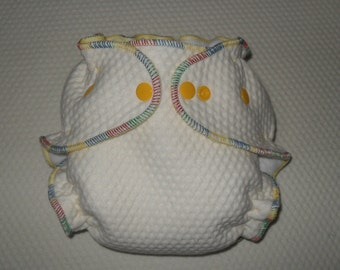 Zorb 2 Fitted diaper with multi colored thread and yellow snaps