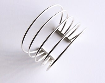 "Prominent silver bracelet, a spectacular piece of statement jewelry made of five pieces of sturdy sterling silver wire - ""Rods Cuff"""
