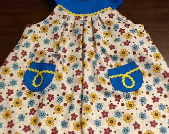 Darling little dress embelished and with pockets.
