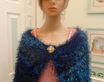CAPE/shrug, Stylish,  hand knitted in a variegated fun fur yarn,shades of turquoise, navy and blue
