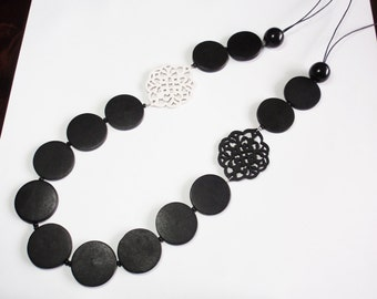 Long black and white wooden laser cut necklace