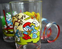 The Smurfs on glasses. Vintage collection from the 1980s.