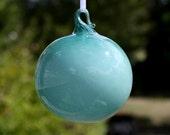 aqua gumball blown glass ornament.