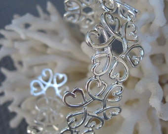 Sterling Silver Flowers and Hearts Cuff Bracelet