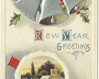 Three Silver Bells Hanging from Swag of Holly Leaves and Holly Berries Winter Church Scene next to river Vintage Postcard