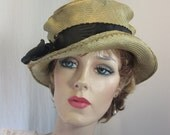 Chic cloche features charming dip in brim and mock top hat crown