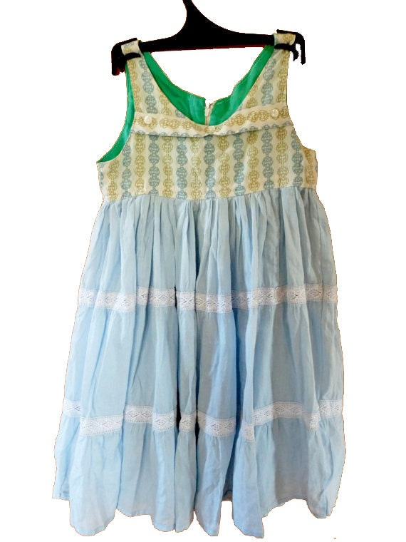 Playful designs and vibrant fabric blooms make up the Laura Ashley collection of girls dresses.