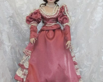 Vintage Collectible Porcelain and Cloth Doll Rose Colored Dress