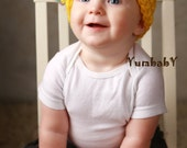 Yellow Easter Hat with large Multi colored pom poms