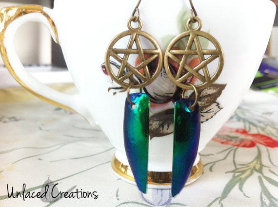 khopre. jewel beetle wing & brass pentacle earrings.