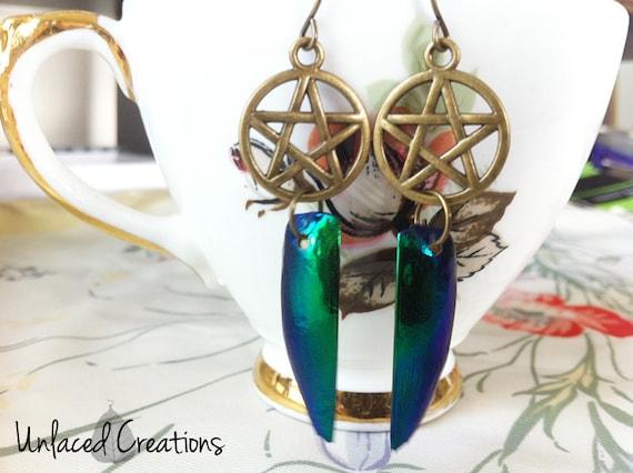 khopre. jewel beetle wing & brass pentacle earrings.
