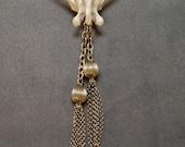 Vintage Brass Necklace with Raccoon Vertebra Bone.