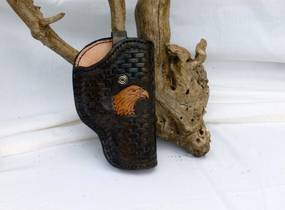 Antique Black Basket Weave with Eagle Head Leather Lined Holster and hand stiched.