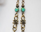 Turquoise Blue Czech glass earrings with intricately carved brass dangles
