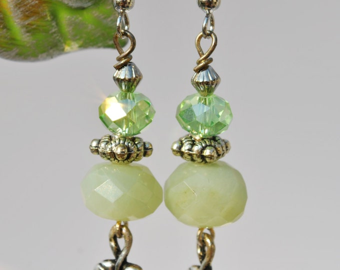 Celery green Czech glass earrings with silver tone leaf dangles