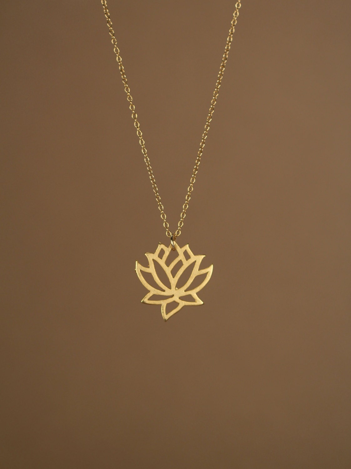 an analysis of the book the three inch golden lotus Free online library: the three-inch golden lotus by world literature today literature, writing, book reviews book reviews books.