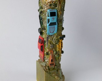 Candle Holder, Cars sculpture, found objects, Asymmetric tower