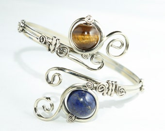 Adjustable upper arm bracelet with a Lapislazuli and a Tiger Eye stones.