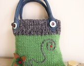 Pretty knitted purse  handbag green with grey trim denim handles and flower design.