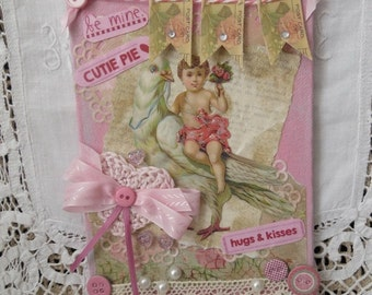 """Canvas board pink wall hanging, Valentine's Day, vintage, painted, dove and cherub, crocheted heart, buttons, lace, ribbon, 5""""x7""""."""